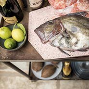A table with Krug Grande Cuvée and Fish